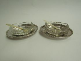 A pair of George III silver table salts, the silver bases accommodating cut glass bowls,