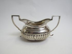 A Maurice Freeman silver twin handled sugar bowl, fluted detail, London 1900,