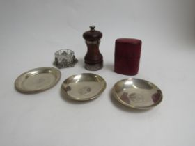 A quantity of silver and white metal pin dishes,