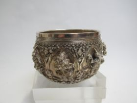 A Burma of Thai (?) white metal pot with deep relief of deities and figures amongst foliage, 436g,