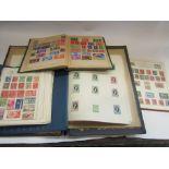 Four stamp albums,