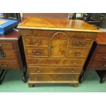 A 17th Century revival walnut chest of four short over three graduating long drawers,