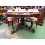 Circa 1840 a circular tilt top table on carved and turned column over scroll foot carved tripod