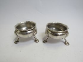 A pair of George III silver salts, fluted rim, shell footed base, marks rubbed,