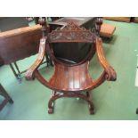 A 19th Century walnut Savonarola chair with carved decoration,