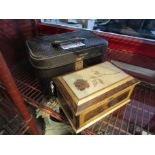 A handcrafted jewellery box with mixed specimen woods including sapele mahogany, bird's eye,