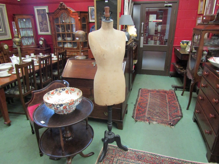 A bygone shop display stockman mannequin on stand
