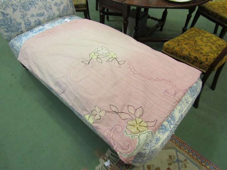 A middle 20th Century pink fine stripe cotton throw with applique hand stitched flowers,