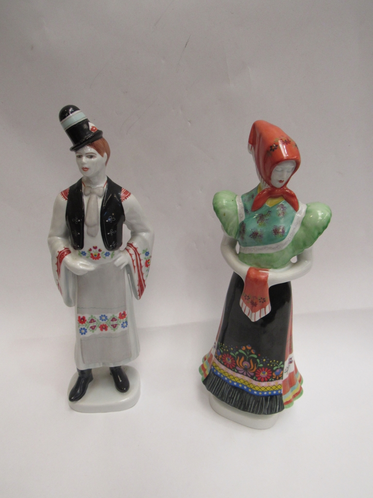 A pair of 20th Century Hungarian figurines, from Hollóháza Porcelain Factory. 30cm high.