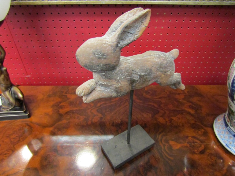 A figure of a rabbit on stand,