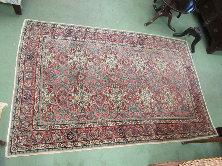 An Eastern wool blue ground rug with multiple borders and five medallion centre,