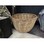 A circular wicker log basket