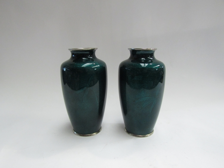 A pair of Japanese cloisonne vases with silver mounted rims and bases,