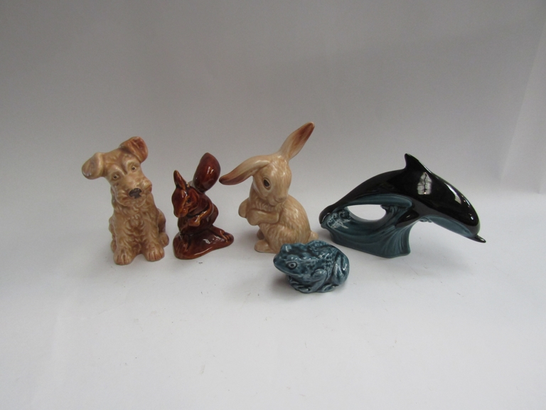 A Sylvac rabbit and dog and Poole dolphin,