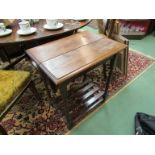 An oak side table with barley twist supports and later added undertray,