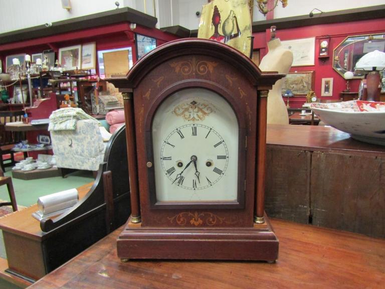 A German striking mahogany inlaid domed top mantel clock,