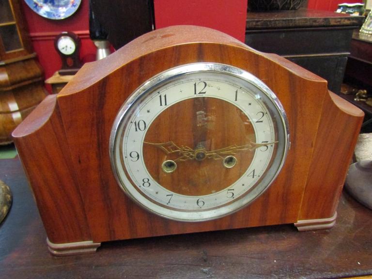An Art Deco walnut mantel clock with Arabic dial,