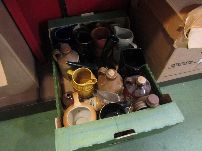 A box of bygone whisky and water jugs etc