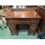 An 18th Century and later mahogany kneehole desk, eight drawers and recessed door,