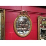 A 19th Century style gilt wall mirror, oval form with ribbon crest,
