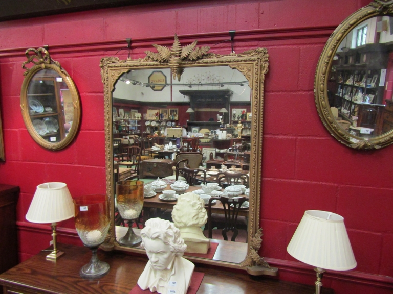 A 19th Century gilt gesso overmantel wall mirror with foliate mounts a/f,