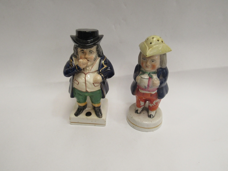 A Victorian Staffordshire pepper pot man and snuff taker