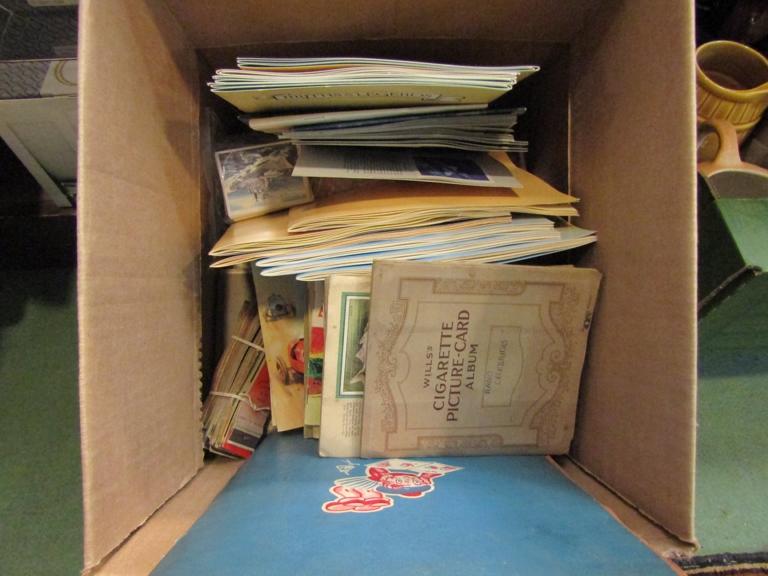 A box of cigarette cards,