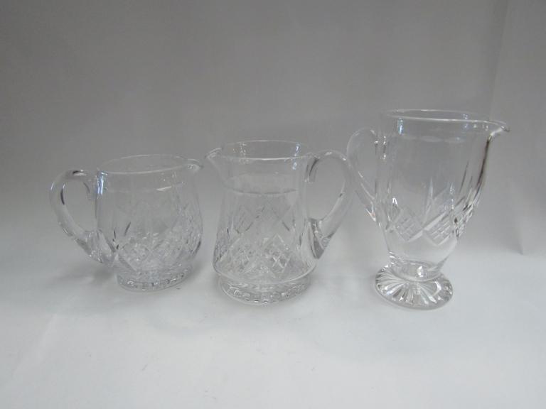 Three Stuart crystal glass water jugs