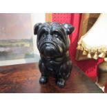A figure of a black pug dog,