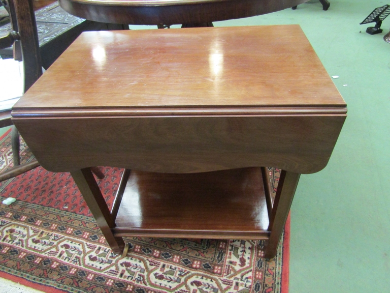 An Edwardian mahogany drop-leaf two tier trolley the galleried under-shelf over later gliding