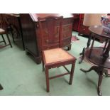 An Edwardian mahogany cane seated bedroom chair,