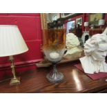 A pair of large crackle glass candle lamps on circular pedestal base,