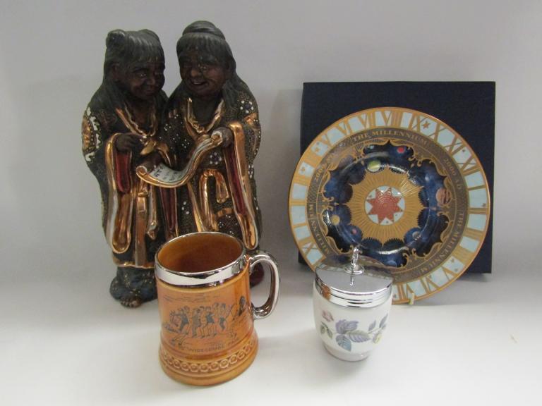 A figural group of monks, egg coddler,