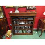 A Victorian walnut bookshelf with height adjustable shelves on a plinth base,
