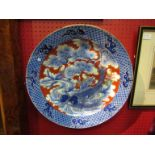 A Victorian Oriental charger, fish and figures design,