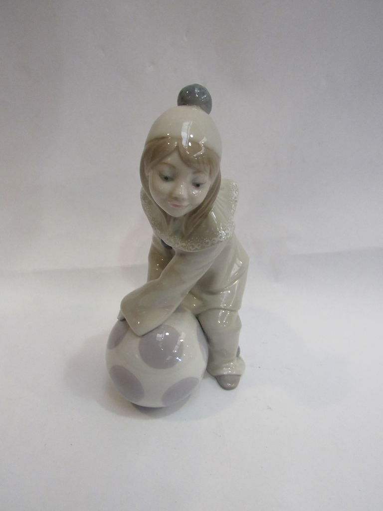 A Lladro figure of girl with ball. 18cm high.