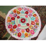 """A Hungarian hand embroidered circular tablecloth, 27"""" diameter, multicoloured,"""