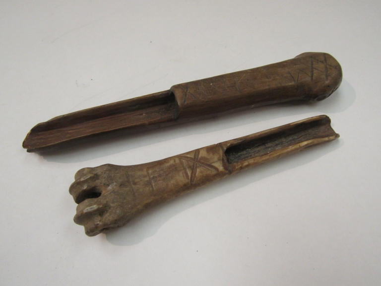 Two carved bone scoops