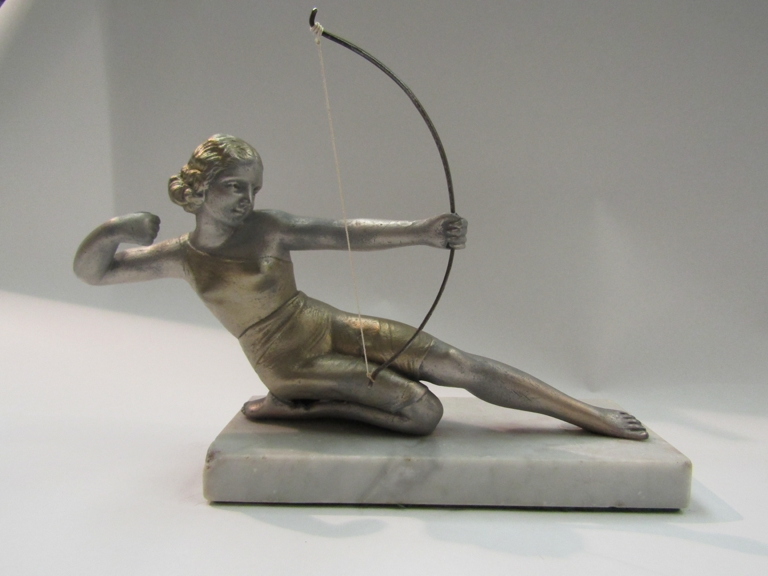 A figure of Diana The Huntress on a marble base,