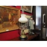 A Victorian glass and brass oil lamp.