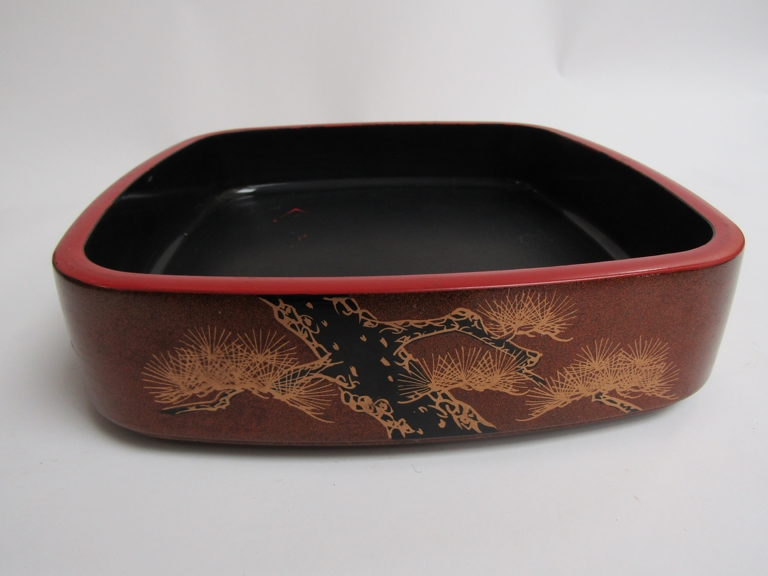 An Oriental black, red and gold lacquered square bowl,