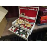 A jewellery box with a selection of costume jewellery