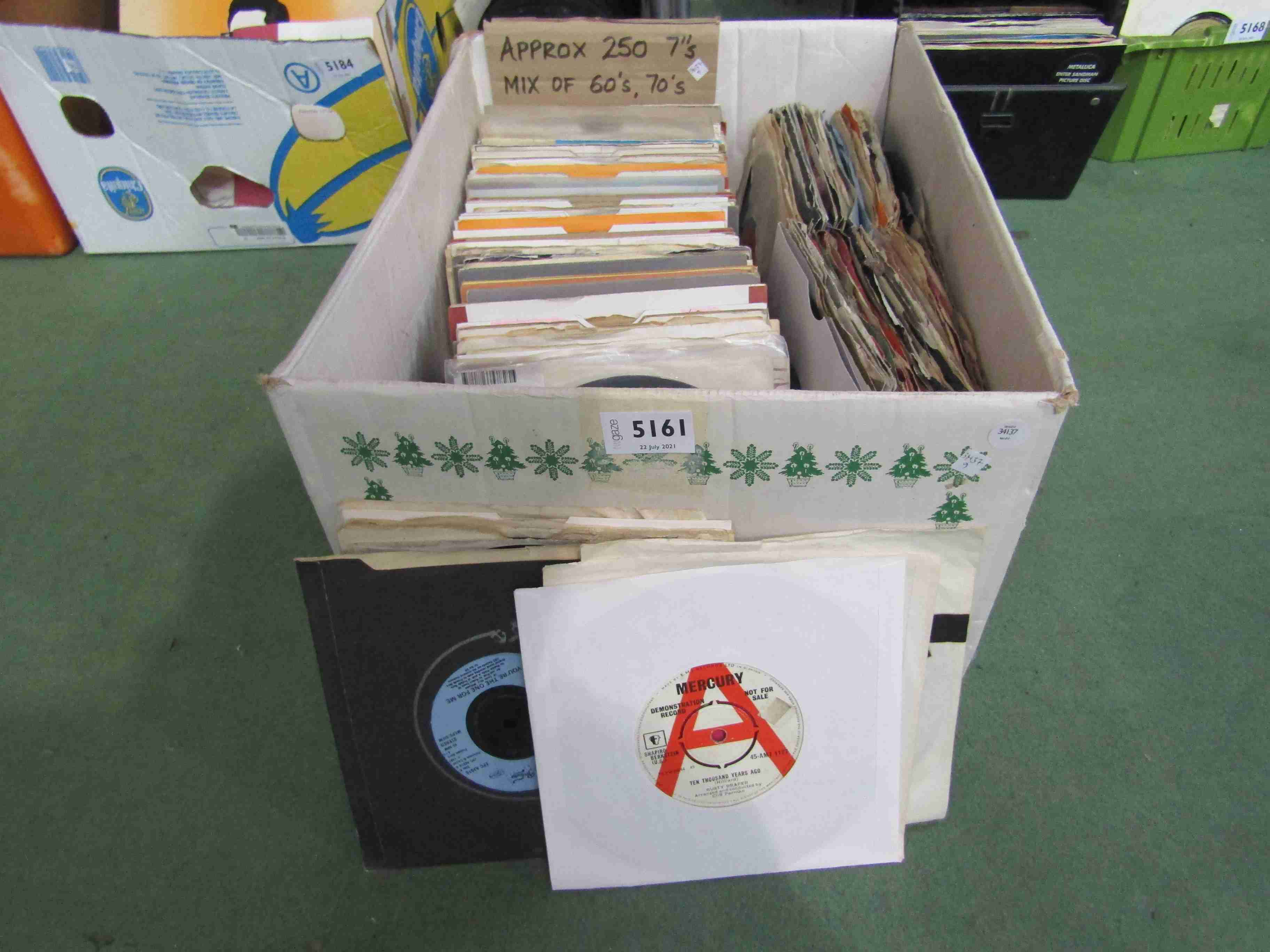 """A box of approximately 250 7"""" singles including Chic, The Equals, Paul Simon,"""