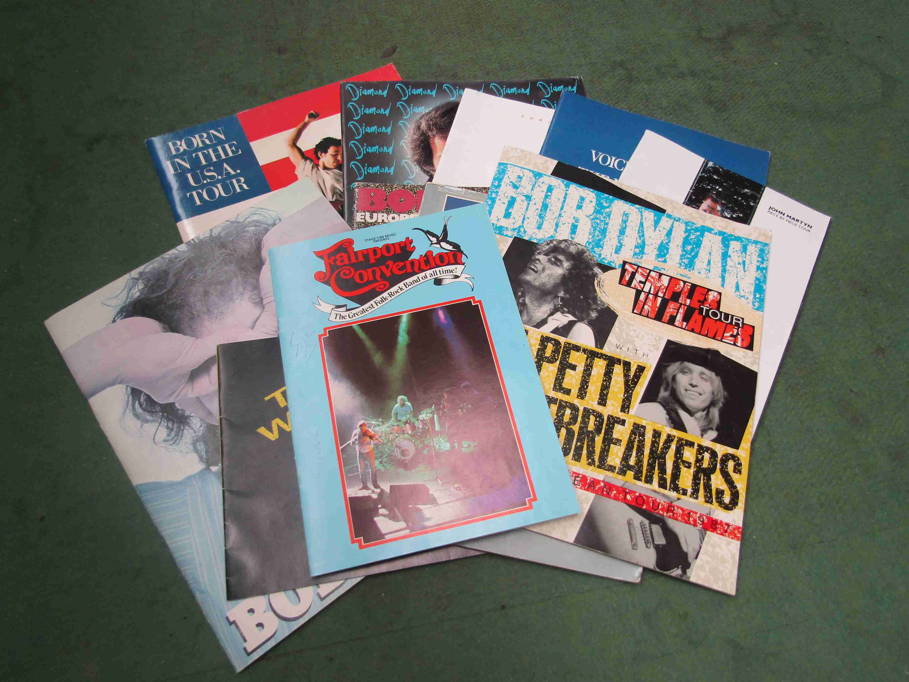 Eleven 1980's tour programmes including Bob Dylan, Fairport Convention (bearing signatures),