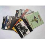 """A collection of Rock LP's and 12"""" singles including Motley Crue, Status Quo, Aerosmith,"""