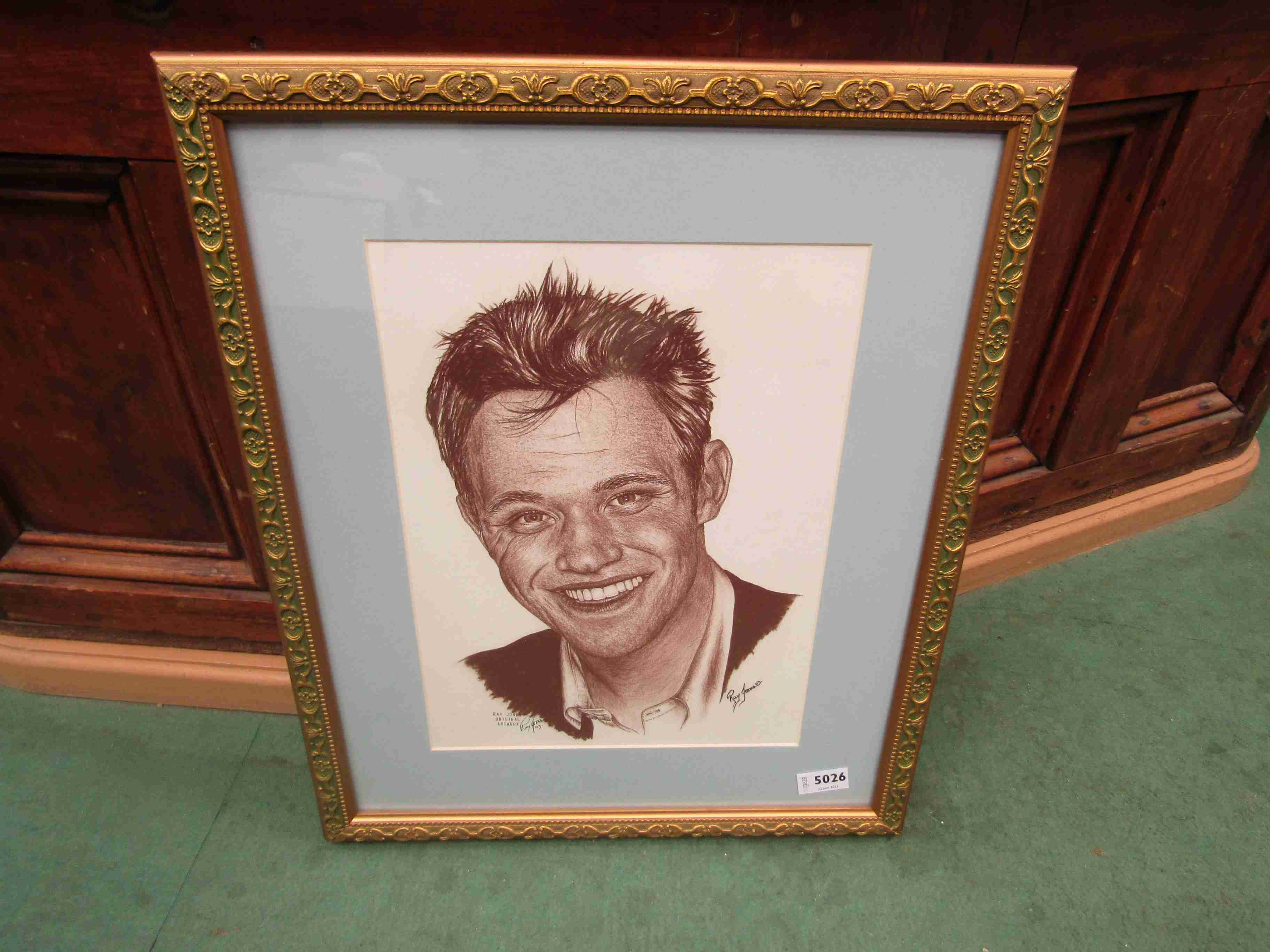 RAY JONES: A framed and glazed pastel portrait of Will Young, signed by the artist