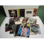 "Twenty three assorted 1980's LP's and 12"" singles including The Clash 'Sandanista',"
