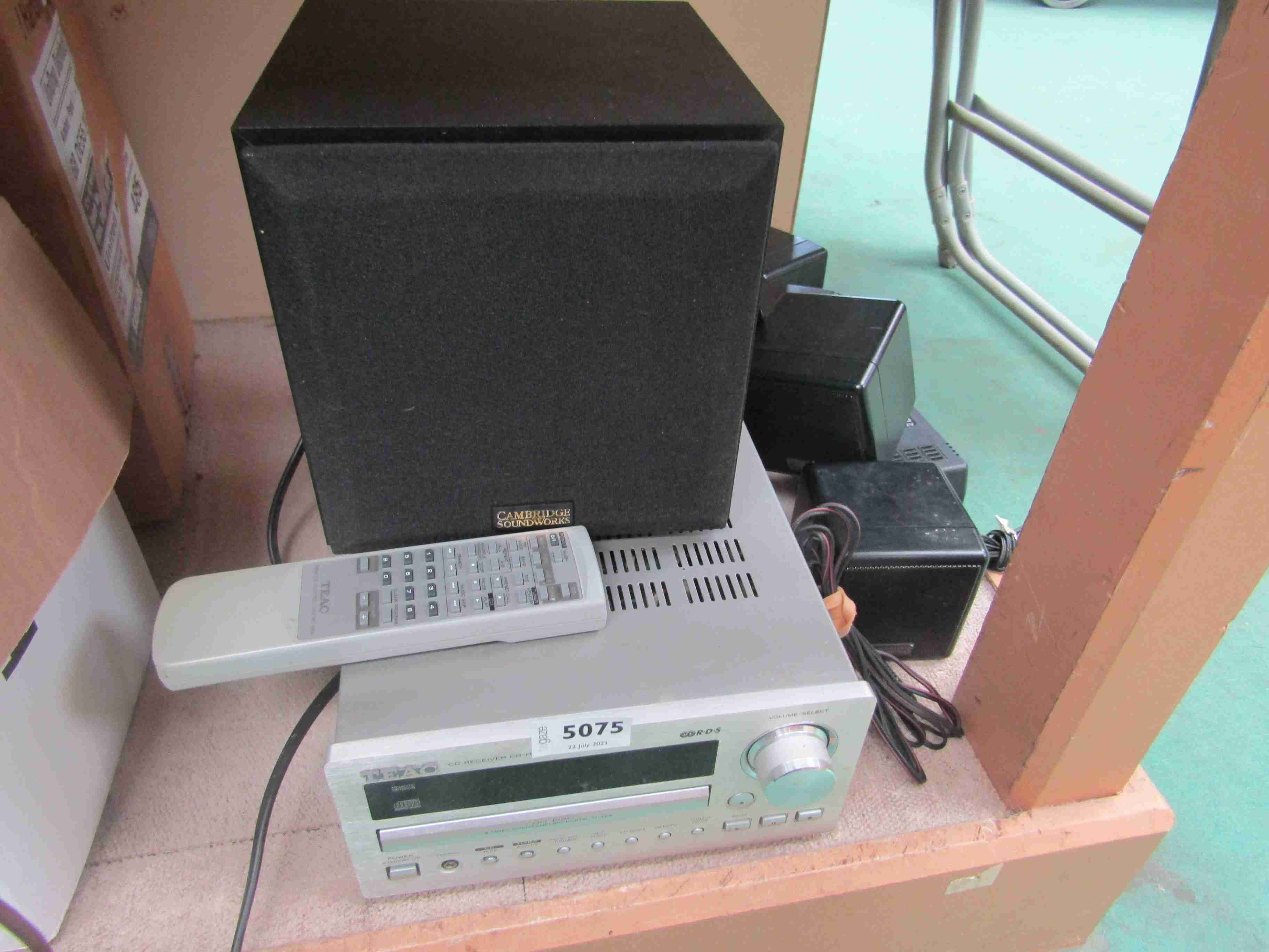 A Teac CR-H230 CD receiver and a Cambridge Soundworks FPS1600 surround sound system