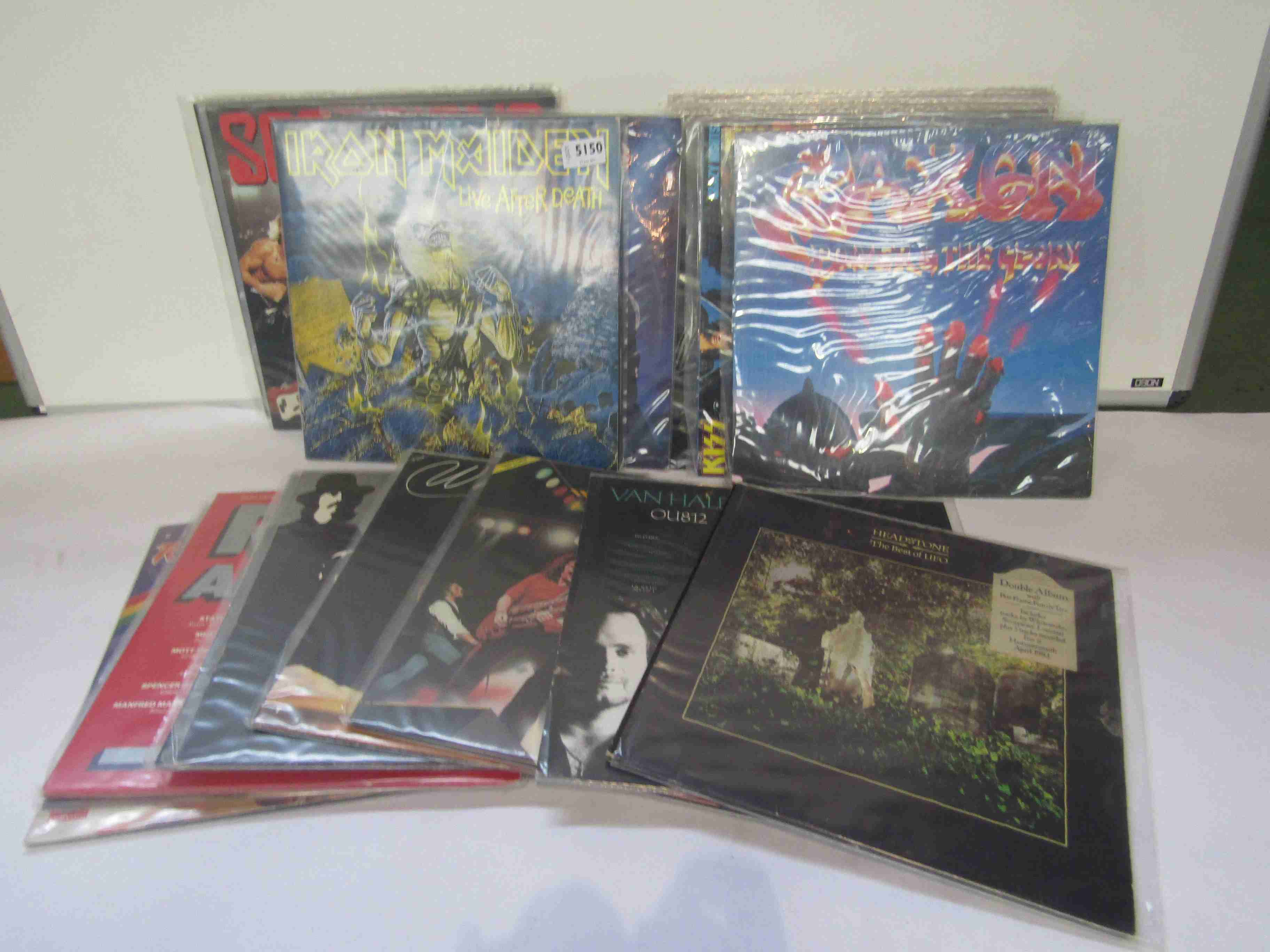 """A collection of Rock and Heavy Metal LPs and 12"""" singles including Iron Maiden, Saxon,"""