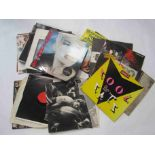 """A collection of mostly 1980s LPs and 12"""" singles including 'Now' compilations, Eurythmics, UB40,"""
